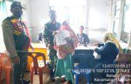*Babinsa Koramil 08 Mandah Serda Tulus Lumban Gaol di Hari Libur tetap kawal penyaluran BST*