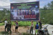 Koramil 11/Pulau burung Kodim 0314/Inhil mengadakan pemasangan Spanduk dalam Rangka HUT TNI Ke - 75 di Wilayah kec. Pulau Burung